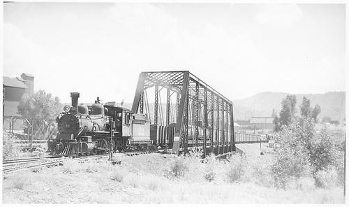 RGS #22 hauling freight over the Las Animas bridge.<br /> RGS  Durango, CO  Taken by Jackson, Richard B. - 7/5/1937