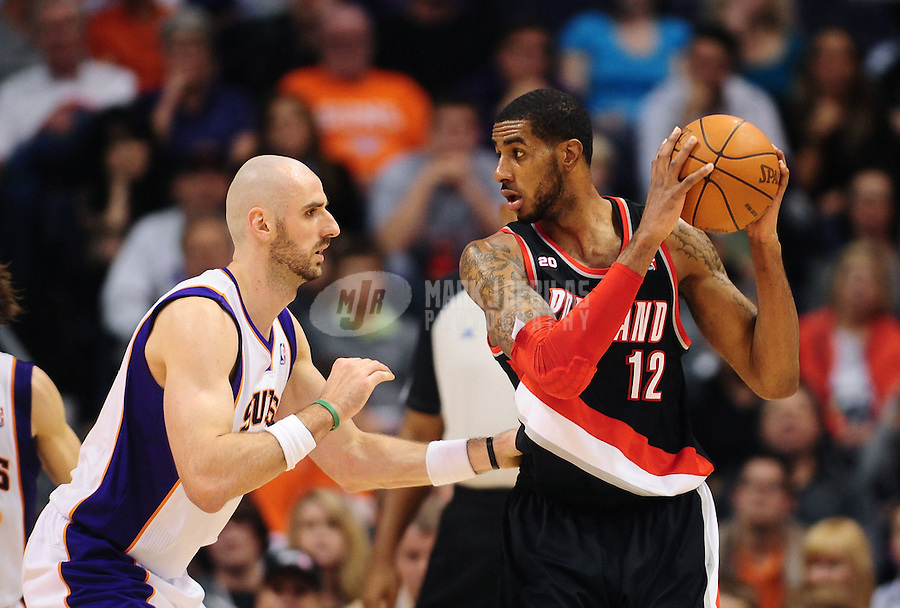 Jan. 14, 2011; Phoenix, AZ, USA; Portland Trailblazers forward (12) LaMarcus Aldridge is defended by Phoenix Suns forward Marcin Gortat at the US Airways Center. The Suns defeated the Trailblazers 115-111. Mandatory Credit: Mark J. Rebilas-