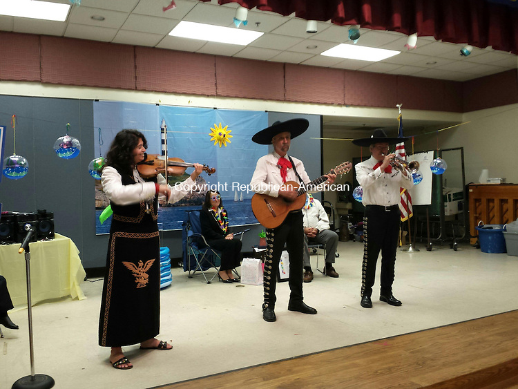 TORRINGTON, CT- 12 June 2014 061214BJ02--Pamela Dzurilla, principal of Vogel-Wetmore School, and her husband, Paul, listen as a Fiesta Del Norte, a mariachi band, performs songs during a surprise retirement party. The Hispanic community held a party for Dzurilla for her support of the community. Bruno Matarazzo Jr. Republican-American