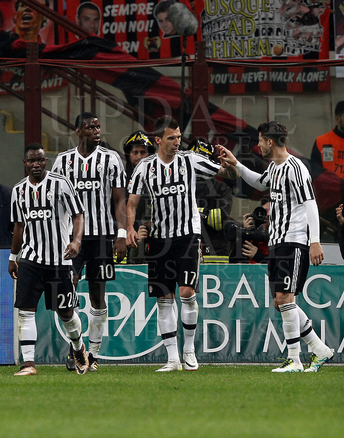 Calcio, Serie A: Milan vs Juventus. Milano, stadio San Siro, 9 aprile 2016. <br /> Juventus' Mario Mandzukic, second from right, celebrates with teammates Kwadwo Asamoah, left, Paul Pogba, second from left, and Alvaro Morata after scoring during the Italian Serie A football match between AC Milan and Juventus at Milan's San Siro stadium, 9 April 2016.<br /> UPDATE IMAGES PRESS/Isabella Bonotto