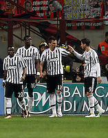 Calcio, Serie A: Milan vs Juventus. Milano, stadio San Siro, 9 aprile 2016. <br /> Juventus&rsquo; Mario Mandzukic, second from right, celebrates with teammates Kwadwo Asamoah, left, Paul Pogba, second from left, and Alvaro Morata after scoring during the Italian Serie A football match between AC Milan and Juventus at Milan's San Siro stadium, 9 April 2016.<br /> UPDATE IMAGES PRESS/Isabella Bonotto