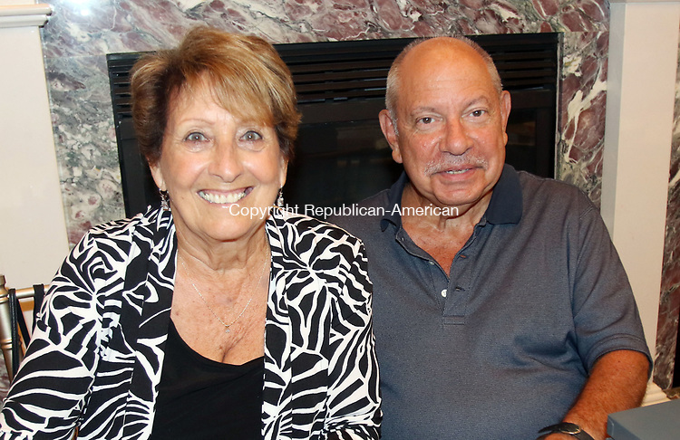 WATERBURY CT. 17 July 2017-071717SV06-From left, Maryann Giarratona of Wolcott and Michael Mucciacciaro of Waterbury attend a dinner to honor the retiring Rev. Ronald Ferraro at La Bella Vista in Waterbury Monday. After 57 years of service, the Rev. Ferraro will retire as pastor of Our Lady of Lourdes Church, where he has served since 1990.<br /> Steven Valenti Republican-American