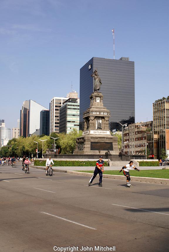 Rollerbladers and bicyclists on Paseo de la Reforma, Mexico City
