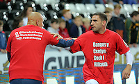 "(L-R) Jonjo Shelvey and Angel Rangel of Swansea warm up wearing a ""Show Racism A Red Card"" before the Barclays Premier League match between Swansea City and Stoke City played at the Liberty Stadium, Swansea on October 19th 2015"