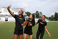 Cary, North Carolina  - Saturday June 17, 2017: Darian Jenkins takes a selfie with Sabrina D'Angelo and Lynn Williams as they wear Nike Equality BeTrue Tees before a regular season National Women's Soccer League (NWSL) match between the North Carolina Courage and the Boston Breakers at Sahlen's Stadium at WakeMed Soccer Park. The Courage won the game 3-1.