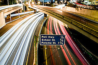 A long-exposure view of traffic on the H-1 Freeway at night in Honolulu, O'ahu