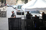 Iseaeli security forces stand guard during Palestinians pray outside the Lion's Gate  main entrance to the Al-Aqsa mosque compound in Jerusalem's Old City on July 24, 2017 as Palestinians protest against Israel's newly-installed security measures at the entrance to the al-Aqsa mosque compound. Photo by Amir Abed Rabbo