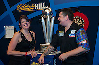 04.01.2015.  London, England.  William Hill PDC World Darts Championship.  Finals Night.  Gary Anderson and his partner Rachel with the Sid Waddell Trophy after beating Phil Taylor (2) [ENG] 7-6 in the final.
