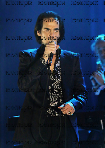 Nick Cave & The Bad Seeds - vocalist Nick Cave - Performing live at the Apollo in Manchester UK - 30 Oct 2013.  Photo credit: Sakura Henderson/IconicPix