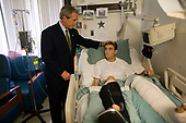 Washington, D.C. - July 1, 2005 -- United States President George W. Bush spends a moment with Corporal Cole Hansen of Canby, Minnesota, during a visit to Walter Reed Army Medical Center Friday, July 1, 2005.  Corporal Hansen is recovering from wounds received while serving in Operation Iraqi Freedom.  White House photo by Eric Draper