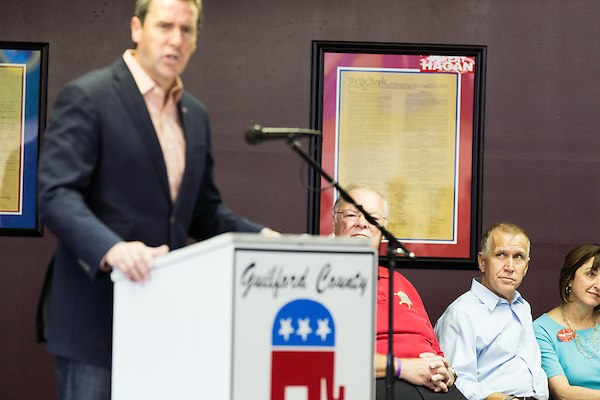 September 20, 2014. Greensboro, North Carolina.<br />  US Congressional candidate Mark Walker gave a short speech to the gathered crowd as US Senate candidate Thom Tillis, at right, looked on.<br />  Thom Tillis and Mark Walker hosted a rally at the Guilford County Republican Party headquarters for their supporters in the upcoming November election. Tillis, the current Speaker of the House for the NC House of Representatives, is running to take Democrat Kay Hagan's US Senate seat, while Walker, a local pastor, is running for the NC 6th District' s US Congressional seat.