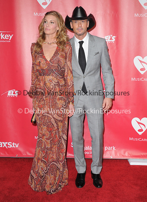 Faith Hill and Tim McGraw at The MusiCares® 2013 Person Of The Year Tribute held at The Los Angeles Convention Center, West Hall in Los Angeles, California on February 08,2013                                                                   Copyright 2013 Hollywood Press Agency