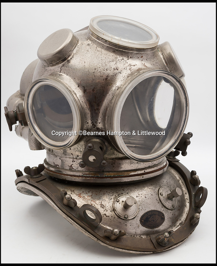 BNPS.co.uk (01202 558833)<br /> Pic: BHandI/BNPS<br /> <br /> A Japanese 12-bolt helium re-breather diving helmet.<br /> <br /> A British couple's lifetime hobby of deep sea diving is set to make them a breathtaking £500,000 when they sell one of the world's finest collection of vintage diving helmets.<br /> <br /> Anthony and Yvonne Pardoe amassed over 150 heavyweight copper helmets worn by divers during the early days of underwater excavation.<br /> <br /> Weighing about 55lbs, the dome-shaped helmets bolted onto a copper collar of a diving suit and had a hose attached to the rear to provide air supply from the surface.<br /> <br /> They are being sold in Devon next month.