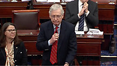 In this image from United States Senate television, US Senate Majority Leader Mitch McConnell (Republican of Kentucky) makes a motion to adjourn during the President's impeachment trial of US President Donald J. Trump in the US Senate in the US Capitol in Washington, DC on Saturday, January 25, 2020.  The Senate stands in adjournment until Monday, January 27, 2020.<br /> Mandatory Credit: US Senate Television via CNP