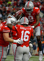 Ohio State Buckeyes wide receiver Binjimen Victor (9) and Ohio State Buckeyes offensive lineman Billy Price (54) celebrate with Ohio State Buckeyes quarterback J.T. Barrett (16) after Barrett scored a touchdown during the first quarter of a NCAA college football game between the Ohio State Buckeyes and the Illinois Fighting Illini on Saturday, November 18, 2017 at Ohio Stadium in Columbus, Ohio. [Joshua A. Bickel/Dispatch]