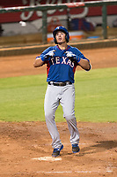 AZL Rangers right fielder Beder Gutierrez (8) celebrates after hitting a two-run home run in the top of the 12th inning of an Arizona League playoff game against the AZL Indians 1 at Goodyear Ballpark on August 28, 2018 in Goodyear, Arizona. The AZL Rangers defeated the AZL Indians 1 7-4. (Zachary Lucy/Four Seam Images)