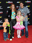 "Angie Everhart and family arriving at Disney's ""Muppets Most Wanted"" Los Angeles Premiere, held at El Capitan Theatre March 11, 2014."