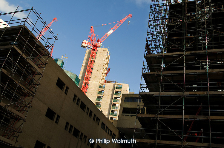 Cranes on a construction site at the Barbican in the City of London.