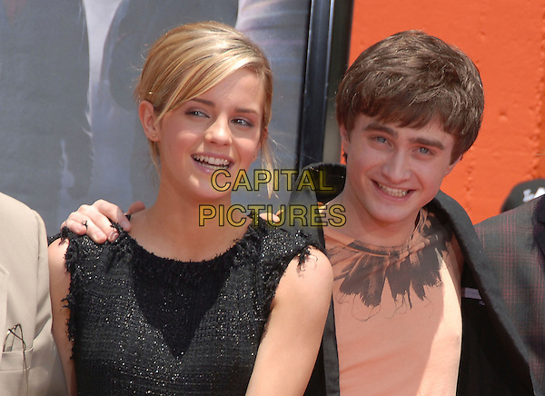 "EMMA WATSON, DANIEL RADCLIFFE .at The Warner Brothers Presents ""Harry Potter and The Order of The Phoenix"" Hand, Foot & Wand Ceremony held at The Grauman's Chinese Theatre in Hollywood, California, USA, July 09 2007.                                                                                           half length hand on shoulder.CAP/DVS.©Debbie VanStory/Capital Pictures"