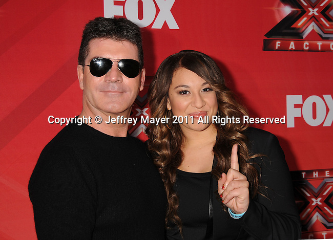 LOS ANGELES, CA - DECEMBER 19: Simon Cowell and Melanie Amaro attend 'The X Factor' press conference at CBS Televison City on December 19, 2011 in Los Angeles, California.