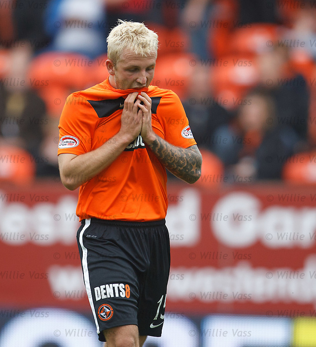Johnny Russell hides his face in shame as he walks off the field after his red card