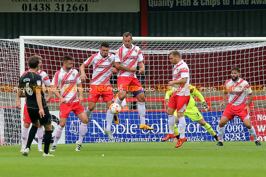 Stevenage players combine to block a free-kick from MK Dons Ed Upson during Stevenage vs MK Dons, Friendly Match Football at the Lamex Stadium on 30th July 2016