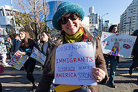 A woman proudly shares her immigrant history at a protest march and rally organised by the Alliance for an Inclusive America group against the perceived anti-Muslim and anti-foreigner immigration policies of President Donald Trump, Shibuya, Tokyo, Japan. Sunday February 12th 2017. The Alliance of an Inclusive America is a multi-faith non-partisan group. About 250 Americans, other ex-pats and japanese people took part in the march to show people around the world they reject the Executive Order President Trump enacted at the end of January, indefinitely suspending the resettlement of Syrian refugees and temporarily banning people from seven majority Muslim countries from entering the United States.
