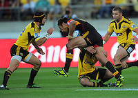 Hurricanes' Jayden Hayward (left) and Aaron Cruden tackle Tana Umaga. Super 15 rugby match - Hurricanes v Chiefs at Westpac Stadium, Wellington, New Zealand on Saturday, 12 March 2011. Photo: Dave Lintott / lintottphoto.co.nz
