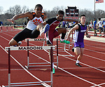 From left: Edwardsville's Xavier McKenney, Belleville West's Cameren Stevens, and Collinsville's Chris Chi in the second section of the 300 meter hurdles at the Norm Armstrong BoysTrack and Field Invitational on Wednesday April 11, 2018. Photo by Tim Vizer