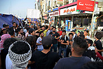 Iraqi protesters take part in an anti-government demonstration in Iraq's southern city of Nasiriyah in Dhi Qar province, on March 20, 2020. Photo by Wadaa al-Aumry