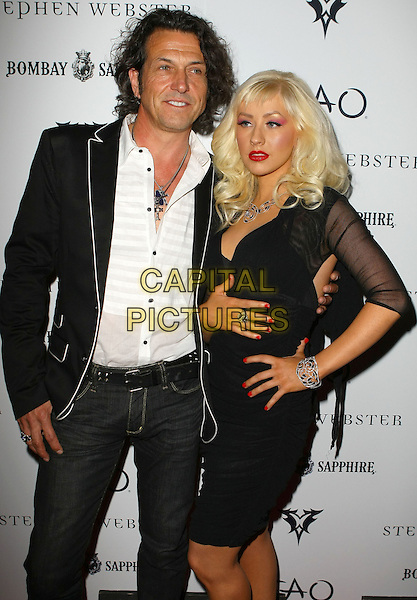 CHRISTINA AGUILERA & STEPHEN WEBSTER .Christina Aguilera Hosts 2009 Collection Launch for Stephen Webster at TAO Nightclub at The Venetian Resort and Casino, Las Vegas, Nevada, USA, .29th May 2009..half length black dress hands on hip jewellery jewelry sheer sleeves .CAP/ADM/MJT.©MJT/Admedia/Capital Pictures