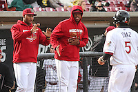 Wisconsin Timber Rattlers pitcher Milton Gomez (22) and outfielder Monte Harrison (3) congratulate teammate outfielder Brandon Diaz (5) after scoring a run during a Midwest League game against the Beloit Snappers on May 30th, 2015 at Fox Cities Stadium in Appleton, Wisconsin. Wisconsin defeated Beloit 5-3 in the completion of a game originally started on May 29th before being suspended by rain with the score tied 3-3 in the sixth inning. (Brad Krause/Four Seam Images)