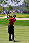 30 August 2009: Tiger Woods hits his approach shot on the 1st hole during the  final round of The Barclays PGA Playoffs at Liberty National Golf Course in Jersey City, New Jersey.