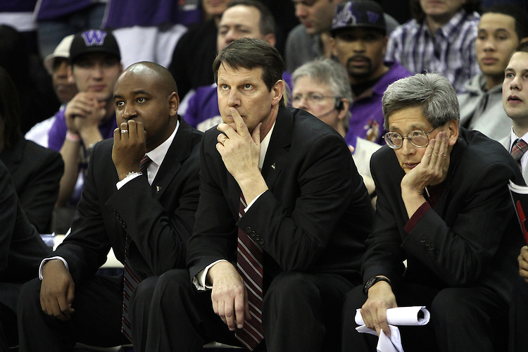 Washington State basketball coaches, Curtis Allen, Ken Bone and Jeff Hironaka, prove that coaching at the college level can be a trying experience despite the Cougars 80-69 road victory over arch-rival Washington at the Alaska Airlines Arena in Seattle, Washington, on February 27, 2011.  With the victory, the Cougars swept the regular season series from the Huskies, two games to none.