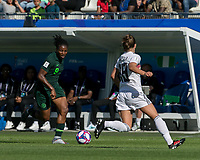 GRENOBLE, FRANCE - JUNE 22: Desire Oparanozie #9 of the Nigerian National Team dribbles at midfield during a game between Nigeria and Germany at Stade des Alpes on June 22, 2019 in Grenoble, France.