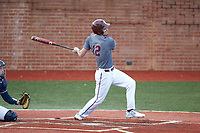 Anthony Stehlin (12) of the Concord Mountain Lions follows through on his swing against the Wingate Bulldogs at Ron Christopher Stadium on February 1, 2020 in Wingate, North Carolina. The Bulldogs defeated the Mountain Lions 8-0 in game one of a doubleheader. (Brian Westerholt/Four Seam Images)