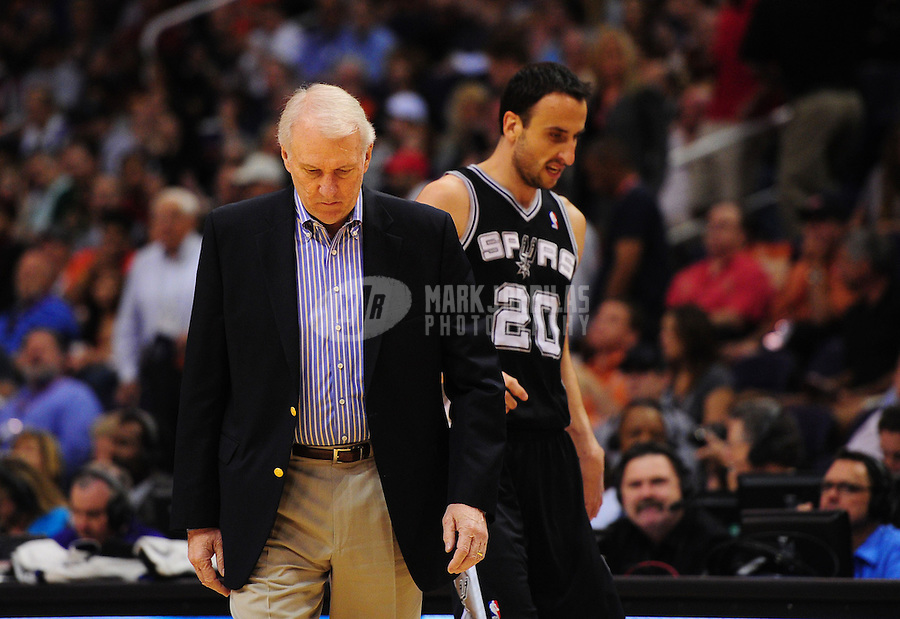 Apr. 13, 2011; Phoenix, AZ, USA; San Antonio Spurs head coach Gregg Popovich and guard Manu Ginobili in the first quarter against the Phoenix Suns at the US Airways Center. Mandatory Credit: Mark J. Rebilas-