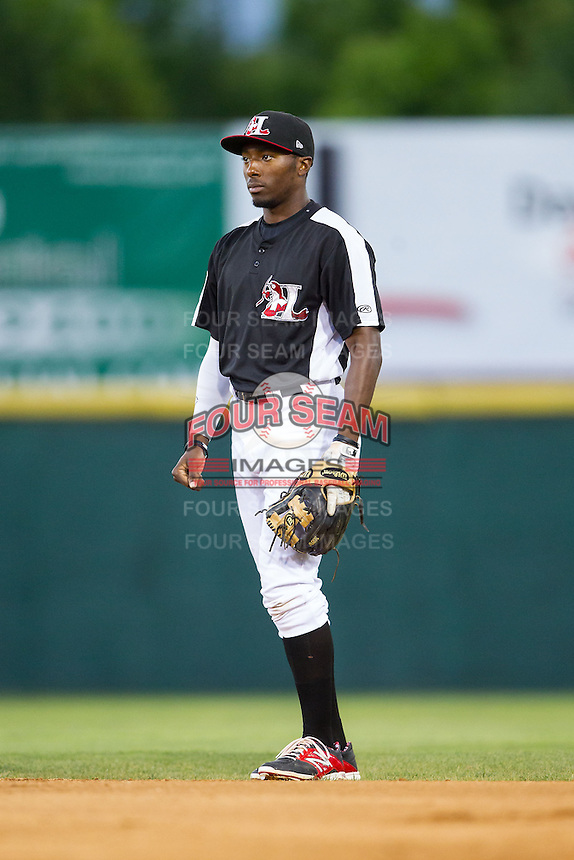Hickory Crawdads second baseman Travis Demeritte (5) on defense against the Charleston RiverDogs at L.P. Frans Stadium on June 2, 2014 in Hickory, North Carolina.  The Crawdads defeated the RiverDogs 9-6.  (Brian Westerholt/Four Seam Images)