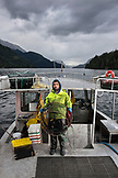 CANADA, Vancouver, British Columbia, Deck Hand Peter Chaucer holds a shrimp pot on the boat Organic Ocean