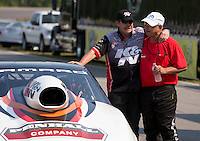 Aug. 18, 2013; Brainerd, MN, USA: V. Gaines (right) congratulates NHRA pro stock driver Mike Edwards after Edwards won the Lucas Oil Nationals at Brainerd International Raceway. Mandatory Credit: Mark J. Rebilas-