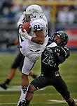 Nevada's Aaron Bradley makes a reception against Hawaii defender Dee Maggitt during the first half of an NCAA college football game in Reno, Nev., on Saturday, Sept. 21, 2013.  Nevada won 31-9. (AP Photo/Cathleen Allison)