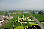 Rice paddy art on display in Inakadate Village in Aomori Prefecture on Sunday 27th July 2014. Inakadate is a small village of 8,000 inhabitants in Norther Japan that has becme famous for creating art in its rice paddy fields by planting a range of colourful rice plants on a rice paddy canvas. This helps attract over 200,000 visitors to the small village each year. This year's designs include a recreation of Mt Fuji and a depiction of the characters from the popular Japanese animation Sazaesan. Every year new creations are displayed from mid-July until September.