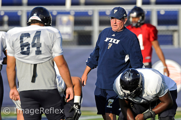 29 March 2013:  FIU Assistant Coach Steve Shankweiler runs players through drills during an open scrimmage for fans at FIU Stadium in Miami, Florida.