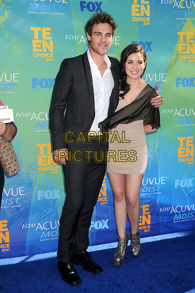 Grey Damon & Grace Phipps.2011 Teen Choice Awards - Arrivals held at Gibson Amphitheatre, , Universal City, California, USA..August 7th, 2011.full length shirt suit dress beige white stubble facial hair black.CAP/ADM/BP.©Byron Purvis/AdMedia/Capital Pictures.