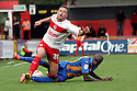 Robbie Rogers of Stevenage is tackled by Marvin Morgan of Shrewsbury.  Stevenage v Shrewsbury Town - npower League 1 -  Lamex Stadium, Stevenage - 1st September, 2012. © Kevin Coleman 2012.