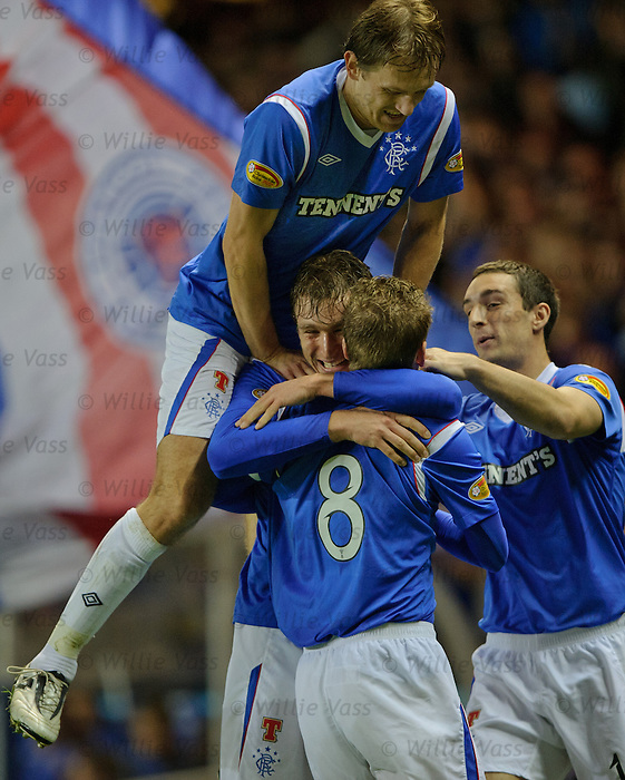 Nikica Jelavic celebreates with Steven Davis, Sasa Papac and Lee Wallace
