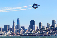 The Blue Angels F/A-18 Hornets in diamond formation pass along the San Francisco Waterfront during San Francisco Fleet Week 2018