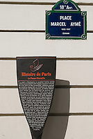 Paris, Historical Marker summarizing story of The Passe-Muraille (Man Who Could Walk Through Walls) by Marcel Ayme.  Also street sign commemorating Place Marcel Ayme, French Writer.  A statue of the PasseMuraille is located in the Place (see photo)