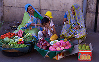 Mumbai, Vendors selling fruit on the street in the Banganga area,India