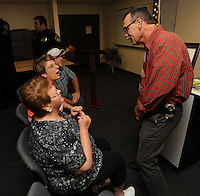 NWA Democrat-Gazette/ANDY SHUPE<br /> John Schuster (right), a detective with the Washington County Sheriff's Office, speaks with Myrrah Mueller (left) of Farmington, and her children Paula Mueller and John Mueller both of Prairie Grove, Wednesday, Sept. 2, 2015, during a ceremony to award the Muellers with the American Police Hall of Fame Medal of Honor at the University of Arkansas Police Department in Fayetteville. Myrrah Mueller's husband, West Fork Police Chief Paul Mueller, was shot and killed on March 20, 1981, while making a traffic stop in West Fork following a robbery in Fayetteville. Schuster, then an officer with the Fayetteville Police Department, was shot twice as he exchanged gunfire with the suspects four days later.